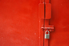 Red metal door. With padlock Stock Photo