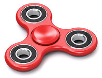 Red metal fidget spinner Royalty Free Stock Photo