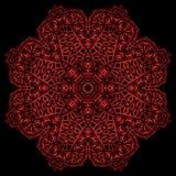 Red metal flower. Red metal mandala on black background Stock Photo