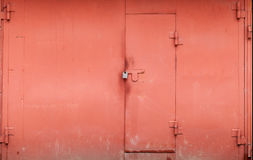 Red metal garage wall with locked gate Stock Photography
