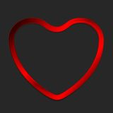 Red metal glow heart on dark background Stock Photos
