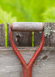Red metal handle of a garden tool Royalty Free Stock Photography