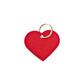 Red metal heart-shaped tag. Closeup of a red metal heart-shaped tag with clipping path. Blank for your text royalty free stock image