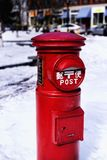 Red Metal Japanese Post Portland Maine. The landmark red post given to the city of Portland Maine from Japan on snow royalty free stock image