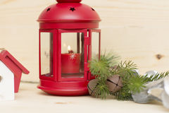 Red metal lantern has a burning candle. Royalty Free Stock Photos