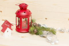 Red metal lantern has a burning candle. Royalty Free Stock Images