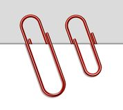Red metal paperclip and paper Royalty Free Stock Photography