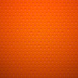Red metal or plastic texture with holes Royalty Free Stock Image