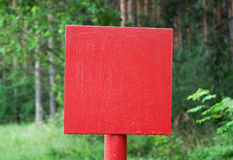 Red metal plate in wood Royalty Free Stock Photos
