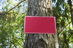 Red metal plate in wood Stock Photo