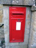 Red metal post box or mail box, London, England Stock Photo