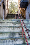 Red Metal Railing Up Old Concrete Steps Stock Photos