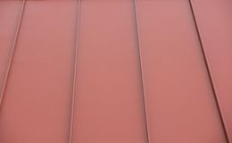 Red metal roof. A detail of a red metal commercial building roof Royalty Free Stock Photo