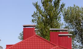 Red metal roof Stock Images
