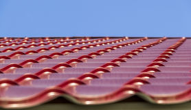 Red metal roof tiles. Red metal tile on the roof of a private house stock photo
