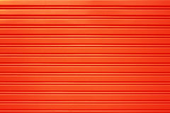 Red metal security roller door background Stock Images
