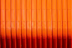 Red metal sheet pattern and vertical line design. Metal sheet pattern and vertical line design on surface abstract aluminum architecture background blank bright royalty free stock photography