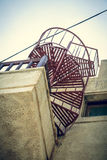 Red metal spiral stair Royalty Free Stock Images