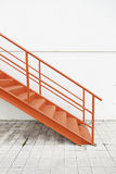 Red metal stairs on the outside Stock Photography