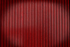 Red metal steel background with bright center spotlight and blac Stock Images