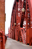 Red metal structures connected by rivets Broadway bridge. Spectacular red metal structures connected by rivets Broadway bridge with lanterns through the stock image