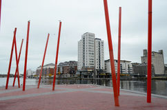 Red Metal Structures in The Grand Canal Square at The River Liffey in Dublin, Ireland Stock Images
