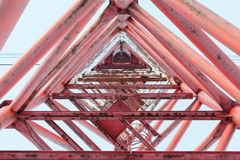 Red metal structures Telecommunications tower. With stairs and blue sky Stock Photos