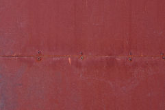 Red metal texture with rivets Royalty Free Stock Images