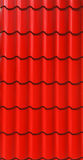 Red metal tile sheet isolated on white background. Red corrugated tile element of roof Royalty Free Stock Photo