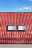 Red Metal tiled Roof with New Dormers, Roof Windows, Skylights and Roof Protection from Snow Boardю Stock Photos
