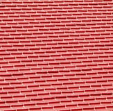 Red metal tiles on a roof Royalty Free Stock Image