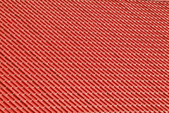 Red metal tiles on a roof Stock Photography