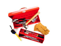 Red metal tool box with tools on white Royalty Free Stock Images