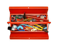 Red metal tool box with tools on white background. Royalty Free Stock Photography