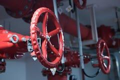 Red metal valve engineering communications. royalty free stock image