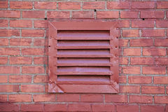 Red Metal Vent on Brick Wall Stock Photography