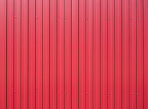 Red metal vertical fence as background Royalty Free Stock Photo