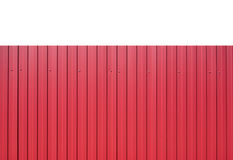 Red metal vertical fence as background isolated closeup. Red metal vertical fence as background isolated on white closeup royalty free stock photography