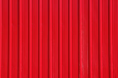 Red Metal Wall. Red aluminum wall with shadowed vertical pattern Stock Photography