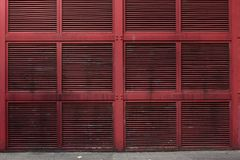 Red metal Wall or air shaft wall of a building Stock Photo