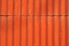 Red metal wall, industrial wall with some ripples and screws. Rusty, painted red and with some bubbles on painting Stock Photos