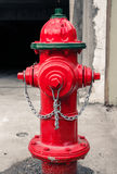 Red metal water hydrant. Photograph of a Red metal water hydrant Royalty Free Stock Image