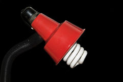 Red Metalic Table Lamp. Table lamp with head and angles on black background. CFL bulb mechanism for light stock photo
