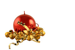 Red Metallic Christmas Candle. With base of gold bells royalty free stock photos