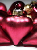 Red metallic Christmas hearts Stock Image