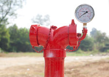 Red metallic fire hydrant with pressure gauge or Fire Department Royalty Free Stock Photos