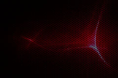 Red metallic mesh and light Stock Images