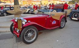 Red MG Sports Car in  town square Rovinj in tour of Croatia. Stock Image