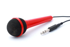 Red Microphone with plug and cable isolated Royalty Free Stock Images