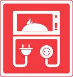 Microwave oven with dish. Red microwave oven symbol with dish Royalty Free Stock Images